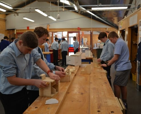 Students doing wood work