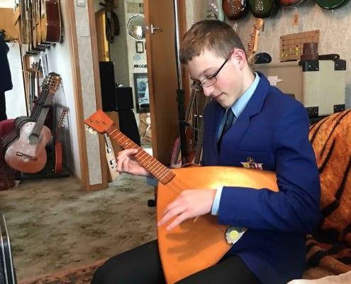 SBC Choir student playing instrument